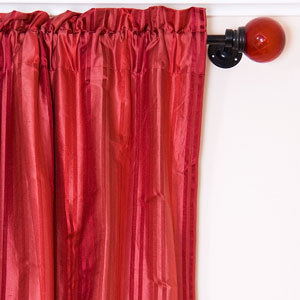 red drapes hanging from a drapery rod