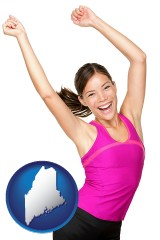 maine a happy young woman wearing fitness clothing