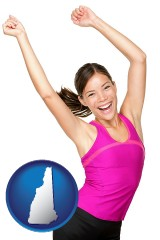 new-hampshire a happy young woman wearing fitness clothing