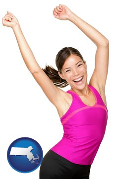 a happy young woman wearing fitness clothing - with Massachusetts icon