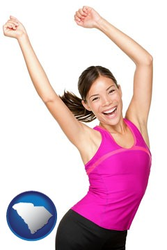 a happy young woman wearing fitness clothing - with South Carolina icon