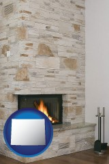 wyoming map icon and a limestone fireplace