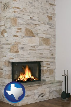 a limestone fireplace - with Texas icon