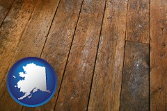 alaska map icon and a distressed wood floor