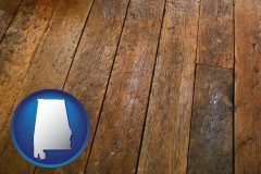 alabama map icon and a distressed wood floor
