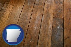 arkansas map icon and a distressed wood floor