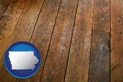 iowa map icon and a distressed wood floor
