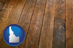 idaho map icon and a distressed wood floor