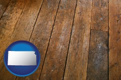 kansas map icon and a distressed wood floor