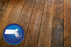 massachusetts map icon and a distressed wood floor