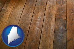 maine map icon and a distressed wood floor