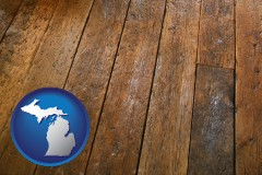 michigan map icon and a distressed wood floor