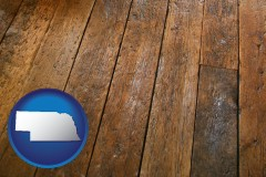 nebraska map icon and a distressed wood floor