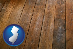 new-jersey map icon and a distressed wood floor