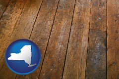 new-york map icon and a distressed wood floor