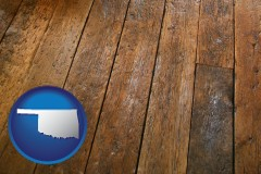 oklahoma map icon and a distressed wood floor