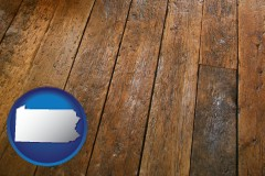 pennsylvania map icon and a distressed wood floor