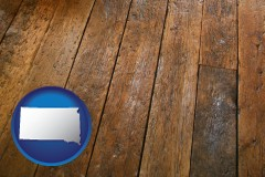 south-dakota map icon and a distressed wood floor