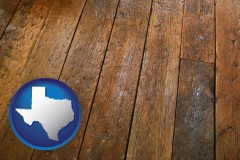 texas map icon and a distressed wood floor