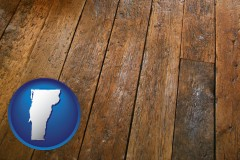 vermont map icon and a distressed wood floor