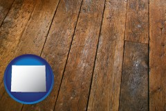 wyoming map icon and a distressed wood floor
