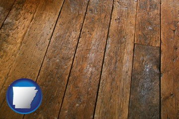 a distressed wood floor - with Arkansas icon
