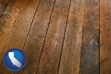 a distressed wood floor - with California icon