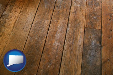 a distressed wood floor - with Connecticut icon