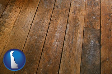 a distressed wood floor - with Delaware icon