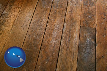 a distressed wood floor - with Hawaii icon
