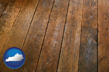 a distressed wood floor - with Kentucky icon