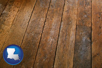 a distressed wood floor - with Louisiana icon