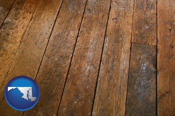 a distressed wood floor - with Maryland icon