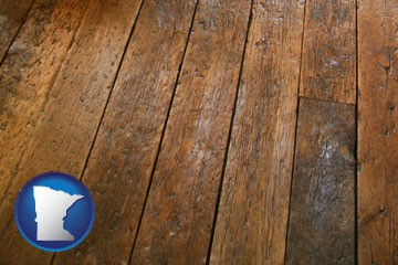 a distressed wood floor - with Minnesota icon