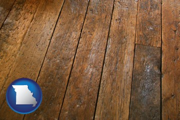 a distressed wood floor - with Missouri icon