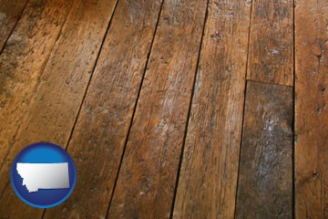 a distressed wood floor - with Montana icon
