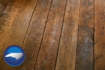 a distressed wood floor - with North Carolina icon