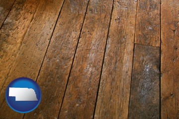 a distressed wood floor - with Nebraska icon