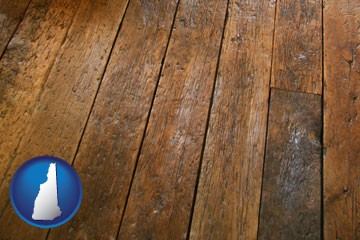 a distressed wood floor - with New Hampshire icon