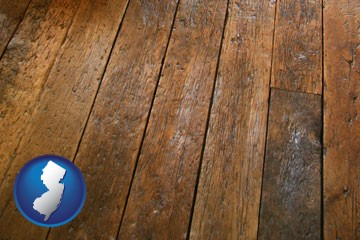 a distressed wood floor - with New Jersey icon