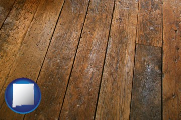 a distressed wood floor - with New Mexico icon