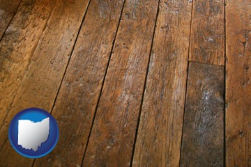 a distressed wood floor - with Ohio icon
