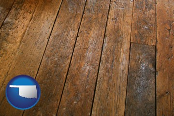 a distressed wood floor - with Oklahoma icon