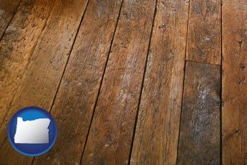 a distressed wood floor - with Oregon icon