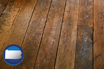 a distressed wood floor - with Pennsylvania icon