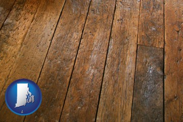 a distressed wood floor - with Rhode Island icon