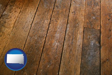 a distressed wood floor - with South Dakota icon