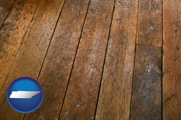 a distressed wood floor - with Tennessee icon