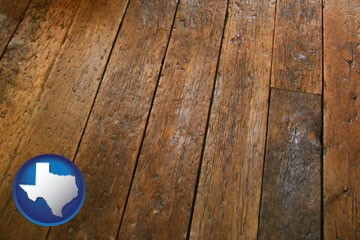 a distressed wood floor - with Texas icon