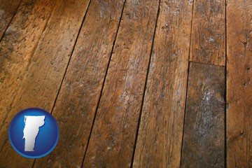 a distressed wood floor - with Vermont icon